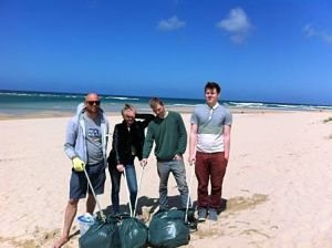Youth Worker Dai Lawton with young people from the programme at Gwithian Beach.jpg